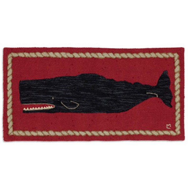 Black Whale on Red Rug
