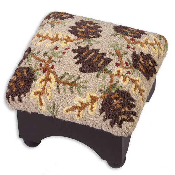 This stool is adorned with a rustic north-woods motif, and filled with pine cones