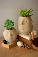 More about the 'Set Of Two Ceramic Face Planters' product
