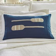 Paddles on indigo pillow
