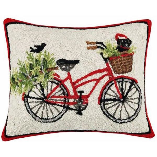 Black dog on bicycle pillow