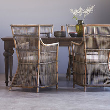 Teak Table with wicker chairs