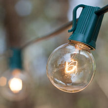 Clear bulbs with green wire
