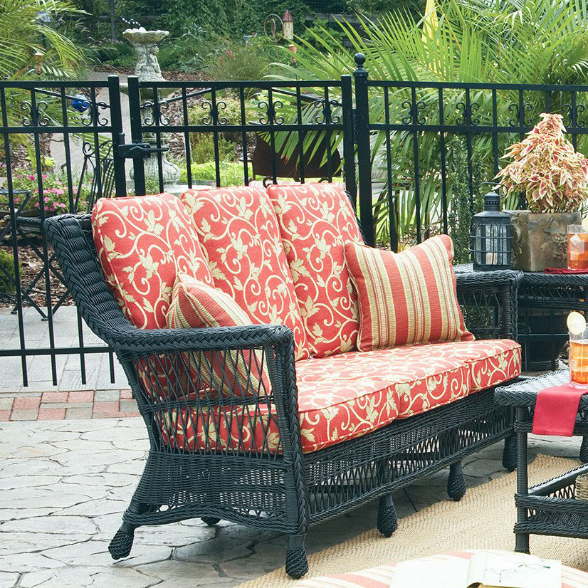 The Legacy Outdoor Wicker Sofa adds class and sophistication